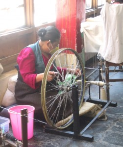 Madam - woman spinning at the Norbulingka Institute
